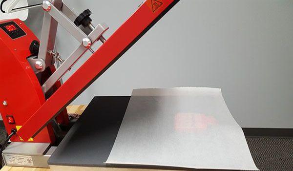 how to clean a heat press machine?